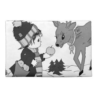 Little boy feeding reindeer in black and white travel accessory bag