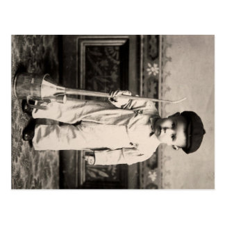 Little boy in overalls, with big oil can postcard