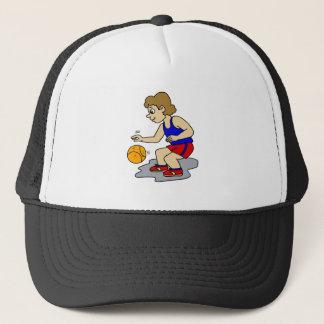 Little boy playing basketball trucker hat
