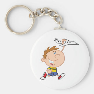 Little Boy Playing With Airplane Toy Keychain