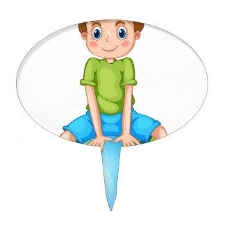 Little boy sitting on blue planet cake topper