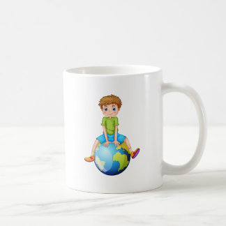 Little boy sitting on blue planet coffee mug