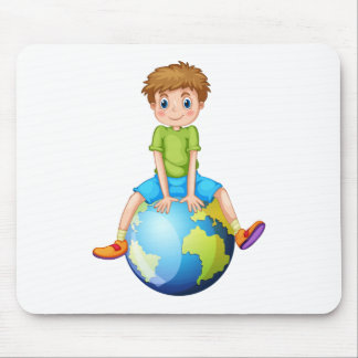 Little boy sitting on blue planet mouse pad