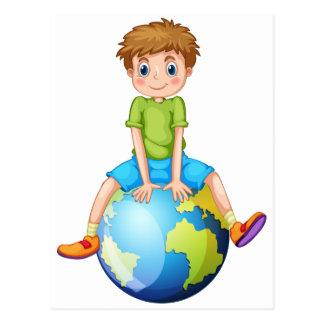 Little boy sitting on blue planet postcard