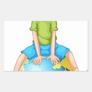 Little boy sitting on blue planet rectangular sticker