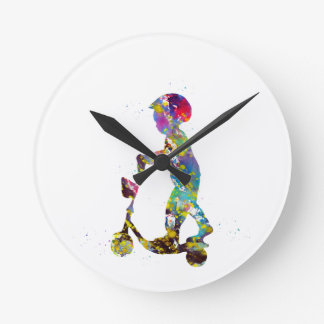 Little boy with scooter round clock
