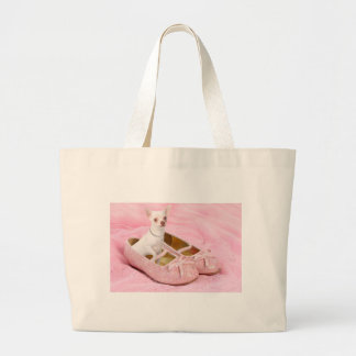 Little chihuahua in pink girly shoes with glitter tote bags