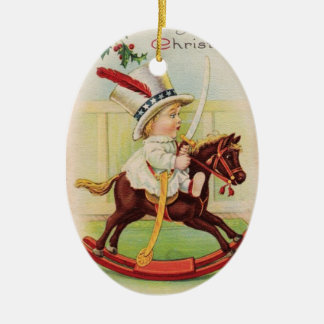 LITTLE CHILD WITH TOP HAT ON THE TOY HORSE CERAMIC ORNAMENT