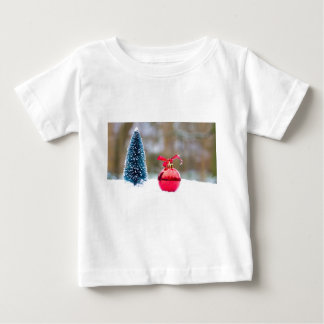 Little christmas tree and red bauble in snow baby T-Shirt