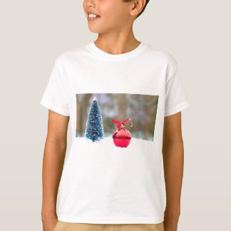 Little christmas tree and red bauble in snow T-Shirt