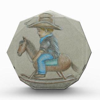 little cowboy riding on toy horse acrylic award