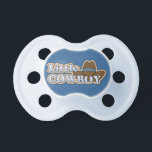 """Little Cowboy Western Hat Pacifier<br><div class=""""desc"""">Brown Western cowboy hat with blue band.  Light blue letters read:  LITTLE COWBOY.  Background color and color of pacifier can be changed.  Simple design for a baby boy or toddler boy.  With a little help from my friends at www.scrappindoodles.com.  From She Wolf Medicine.</div>"""