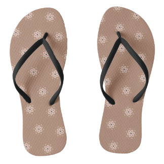Little daisies on a dusty rose colored background flip flops
