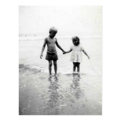 little girl and boy holding hands post card