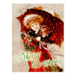 Little girl and puppy in the Christmas snow Postcards