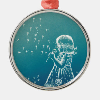 Little girl blowing on a dandelion metal ornament