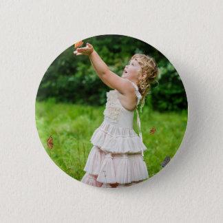 Little Girl Catching a Butterly Button
