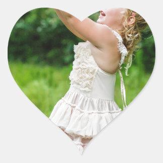 Little Girl Catching a Butterly Heart Sticker