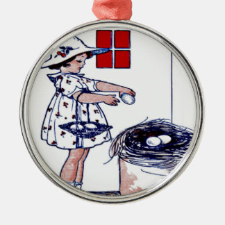 Little girl collecting eggs metal ornament