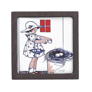 Little girl collecting eggs premium trinket box