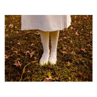 Little girl dressed in white postcard