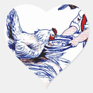 Little girl feeding a rooster heart sticker