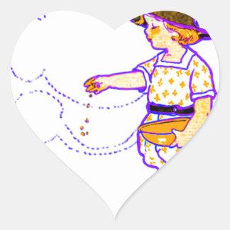 Little girl feeding her baby chicks heart sticker