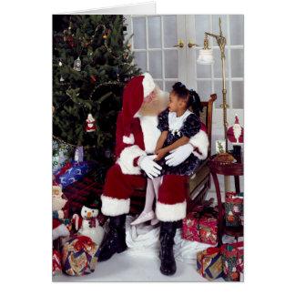 Little Girl Gives Santa a Wishlist Card