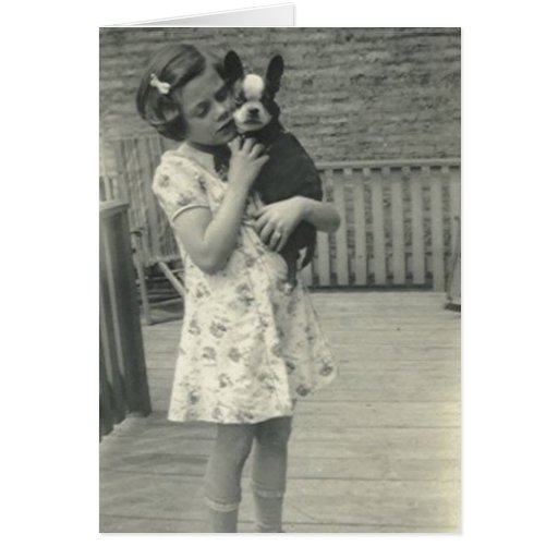 Little girl holding her dog greeting card