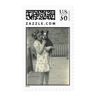 Little girl holding her dog stamp