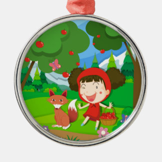 Little girl in red dress and a wolf metal ornament