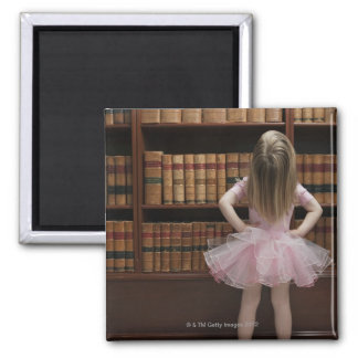 little girl in tutu reading book covers in 2 inch square magnet