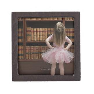 little girl in tutu reading book covers in keepsake box