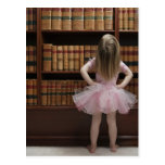 little girl in tutu reading book covers in postcard