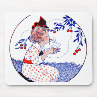 Little girl kissing a baby chick or duck mousepads