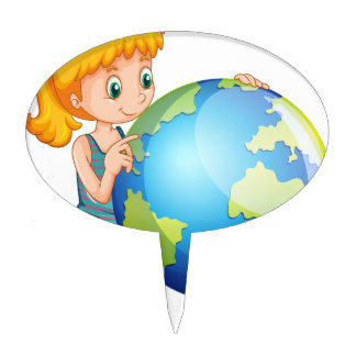 Little girl looking at the globe cake topper