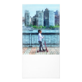 Little Girl on Scooter by Manhattan Skyline Card