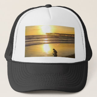 Little Girl Playing on the Beach at Sunset Trucker Hat