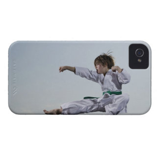 Little girl practicing karate iPhone 4 cases