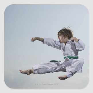 Little girl practicing karate square sticker