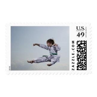 Little girl practicing karate stamp