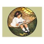 Little Girl reading in a hammock Post Card