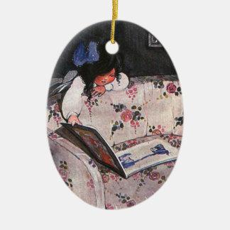 Little Girl reading over sofa Ornament