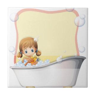 Little girl taking a bath ceramic tile
