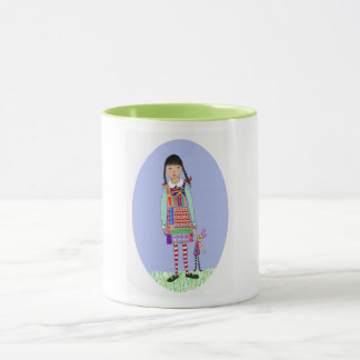 Little girl with bunny toy mug