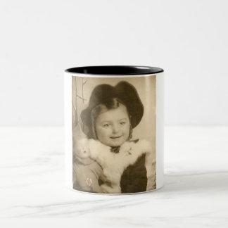 little girl with doll mug