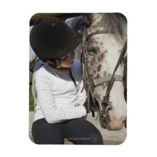 Little girl with her horse magnet