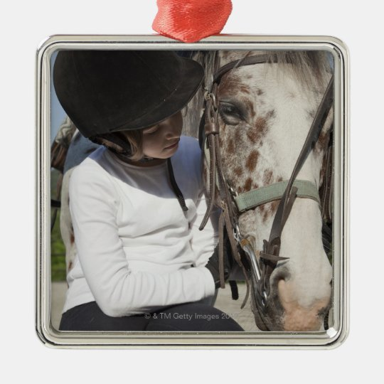 Little girl with her horse metal ornament