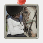 Little girl with her horse ornament