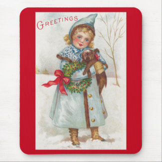 Little girl with puppy mouse pad